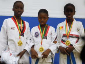 Diakassan, Kadiatou and Astan with their Gold Meda