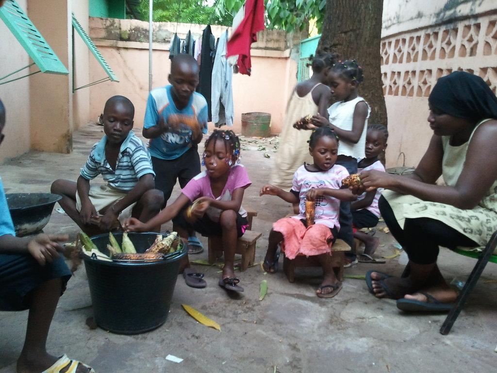 ACFA-Mali Children enjoying roasted corn