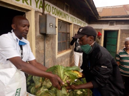 Distributing food to the community