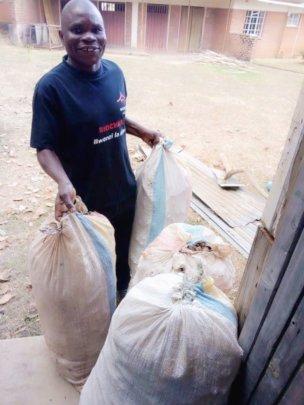 Collecting corn cob for biochar training