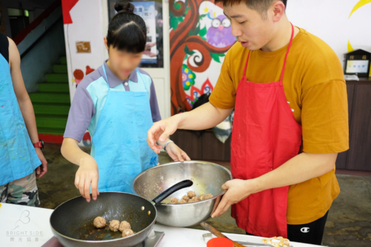 Chef Eric Wu with youth