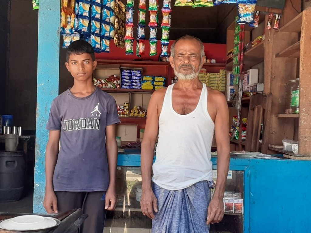 Pial with his father in front of their tea stall