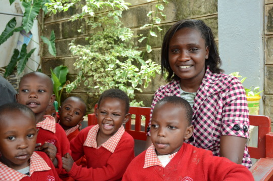 Head Teacher Alice with St. Vincent's Nursery Kids