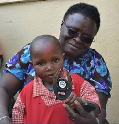 Lucy Kayiwa and Nursery School Student