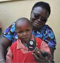 Lucy Kayiwa and Nursery School Student