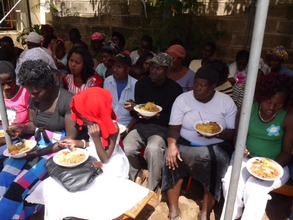 Families receive hot lunch during distribution