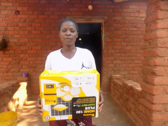 Happy Beneficiary of a solar lamp