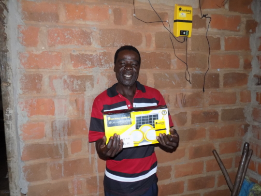 Mr. Tembo with a Solar Lamp