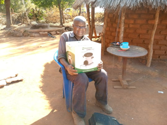 Mr. Hara happy receiving the clean cookstove