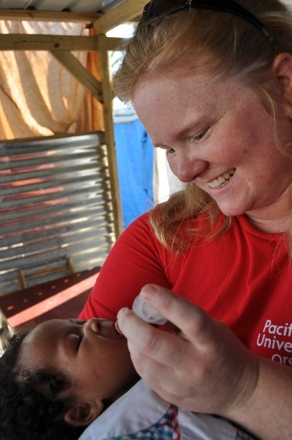 Deworming a baby as part of health education