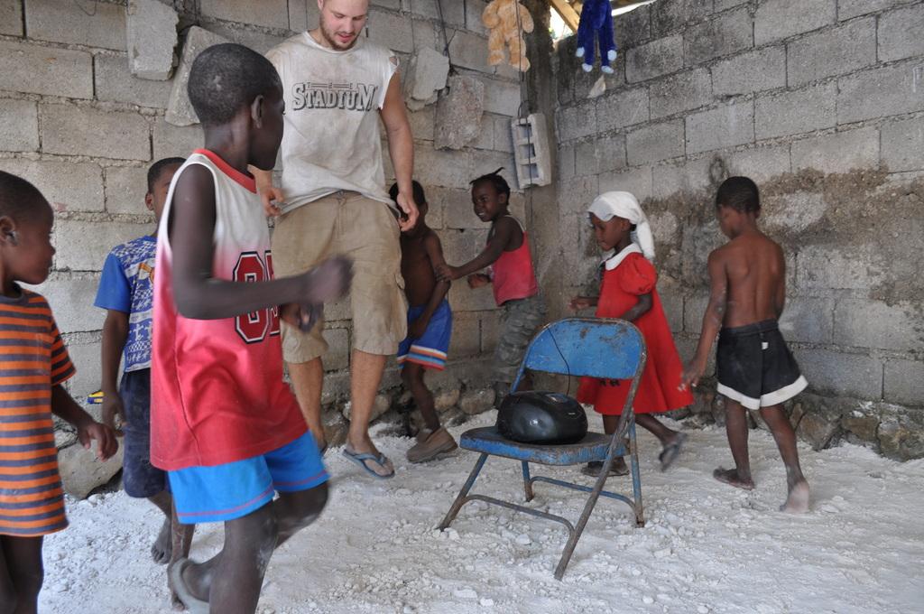 International volunteers and kids playing