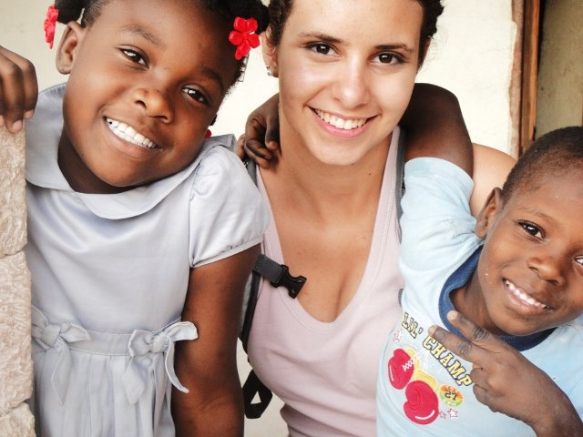 Two orphans with their volunteer english teacher