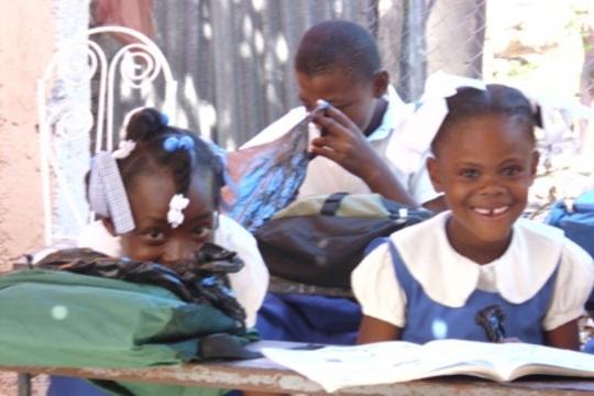 Haitian students receiving supplies