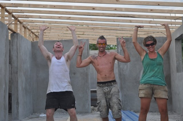 Volunteers raising the roof at Instution Classique