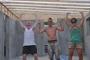 Volunteers raising the roof at Instution Classique