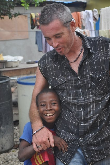 Volunteers and kids enjoying a break