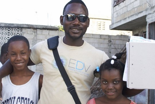 EDV staff and two children we've helped