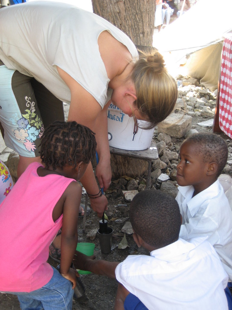 Becca, an EDV volunteer, pouring filtered water