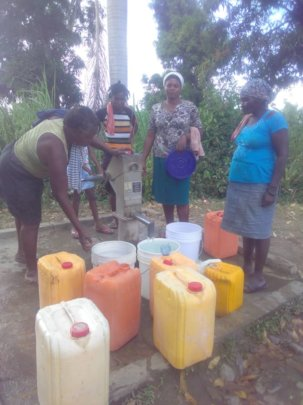 A family in North Haiti pumps Safe & Clean Water!