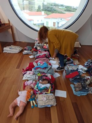 sorting out donated clothes in Azores Island