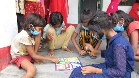 Students learn to play board games during recess.