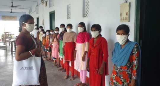 Students Wearing Masks Donated by Eshakti
