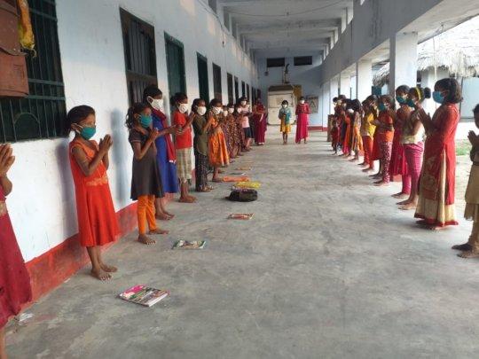School begins with a non-denominational prayer.