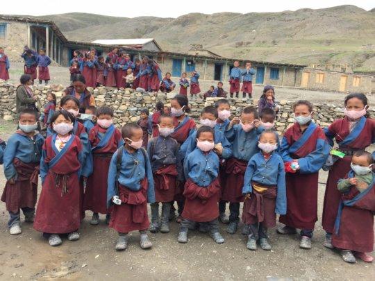 Some students in Saldang school wearing masks