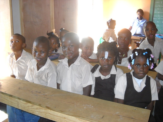 students at new desks in new uniforms