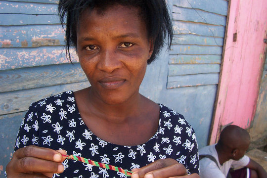 woman holding bracelet she made