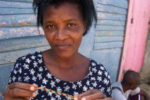 woman holding bracelet she made