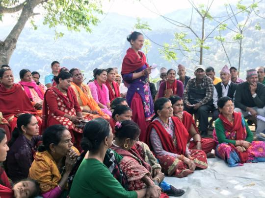 Community members in Nepal meet with EIB mechanism