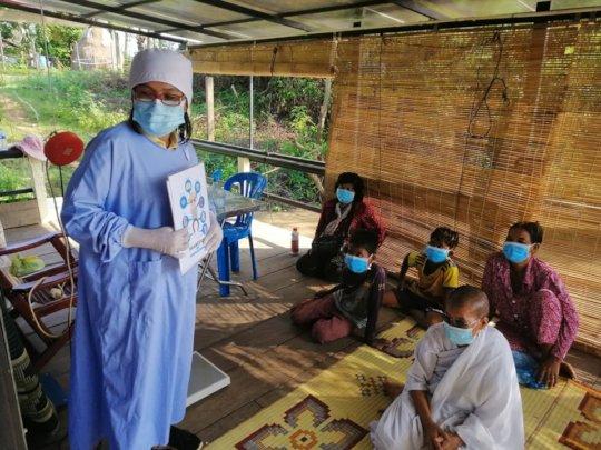 Dr Rida provides health education on the Stung Sen