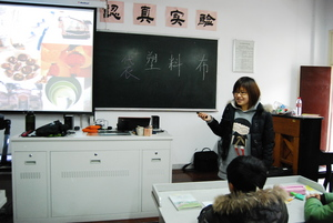 Volunteer Winnie teaches at Paitou middle school