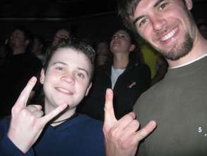 Micah and his friend rock out at Nickelback!