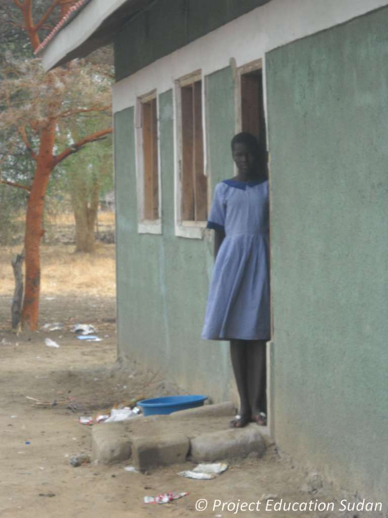 Student In Doorway of Dormitory