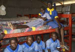 Bunk beds and schoolgirls with new uniforms
