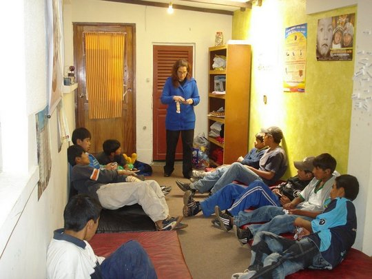 A Psychologist with Students in the Therapy Room