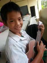 "Aung playing ""Don't Worry, Be Happy"""