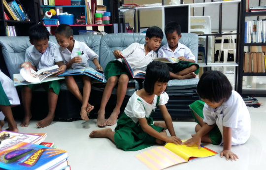 Kids reading in the renewed library