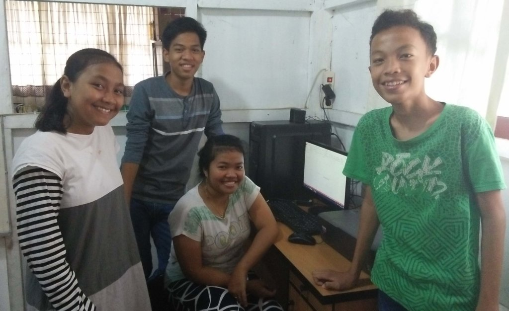 The Middle School students practice using computer