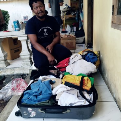 Ewon Selecting Clothes for His Family