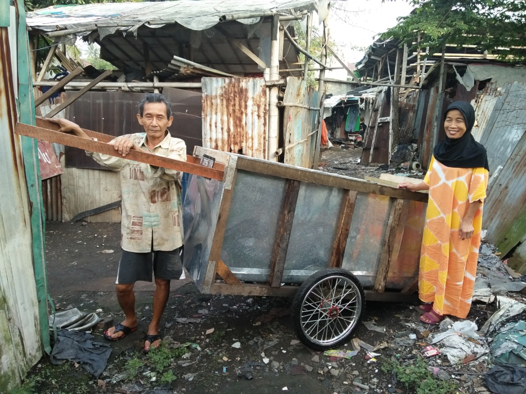 Oman and Asnah with Their New Trash Cart
