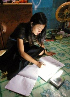 Ariska can study at night using her solar lamp