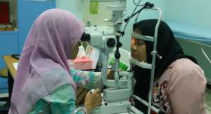 Aminah is having her eyes checked