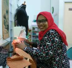 Aminah with new glasses with better sight