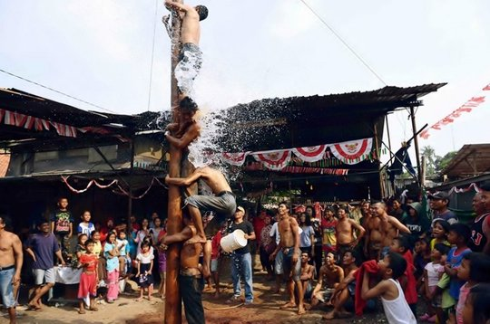 dowsed with water during panjat pinang challenge