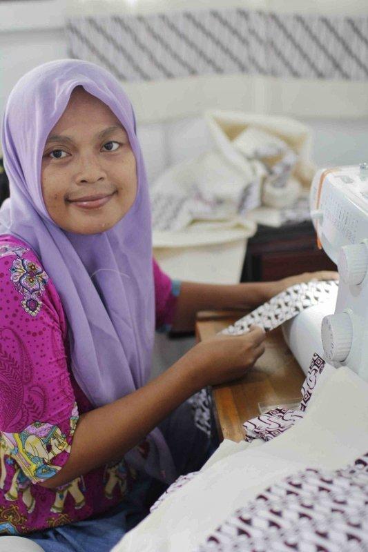 Aryuni at Her Sewing Machine