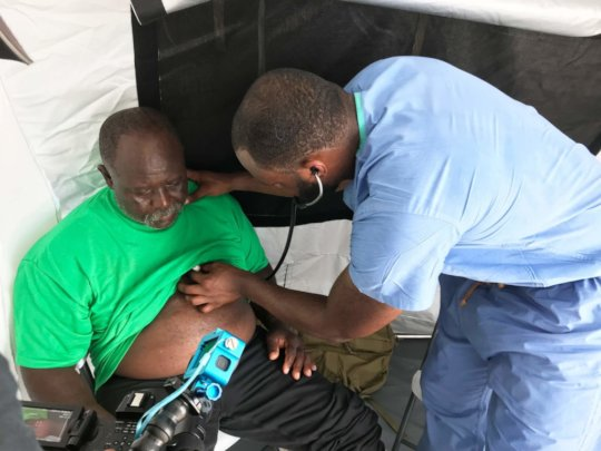 Dr. Myron attending to a High Rock resident.