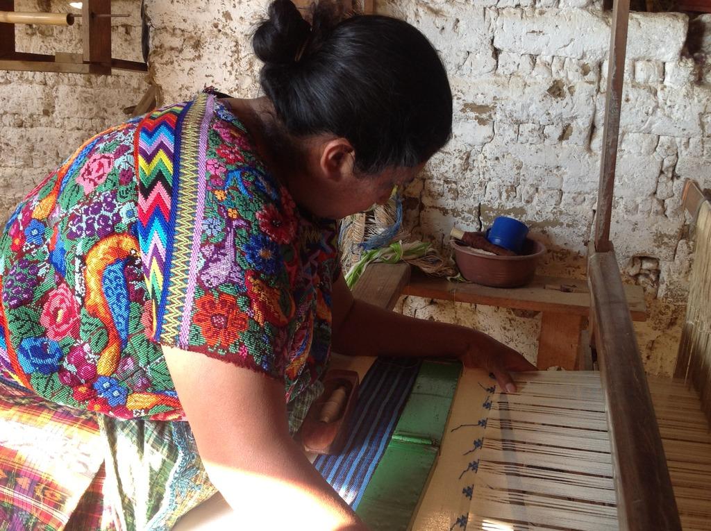 Lili weaving on her treadle foot loom